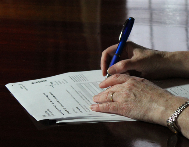 Lasting power of attorney, pen, hands signing